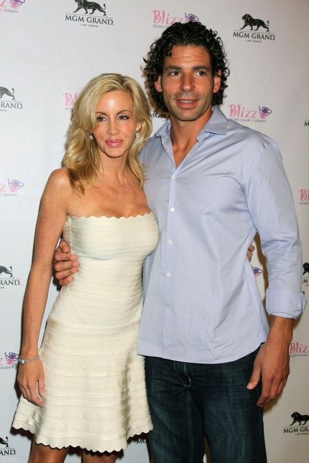Camille Grammer and Dimitri Charalambopoulos, of 'The Real Housewives of Beverly Hills', attend the grand opening of Blizz Frozen Yogurt in Las Vegas