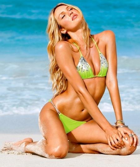 victorias-secret-model-candice-swanepoel-on-the-sandy-beach-beach-442234912
