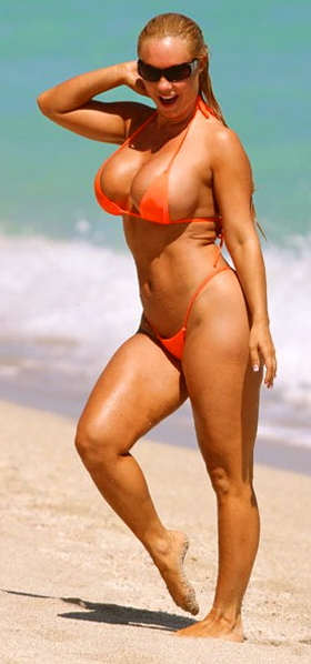 Actor and rapper Ice-T enjoys a day at the beach with his wife, model Nicole 'Coco' Austin. Coco tanned in a tiny orange bikini while Ice-T relaxed in the shade of a beach umbrella. Pictured: Nicole 'Coco' Austin Ref: SPL215875 041010 Picture by: Pichichi / Splash News Splash News and Pictures Los Angeles: 310-821-2666 New York: 212-619-2666 London: 870-934-2666 photodesk@splashnews.com