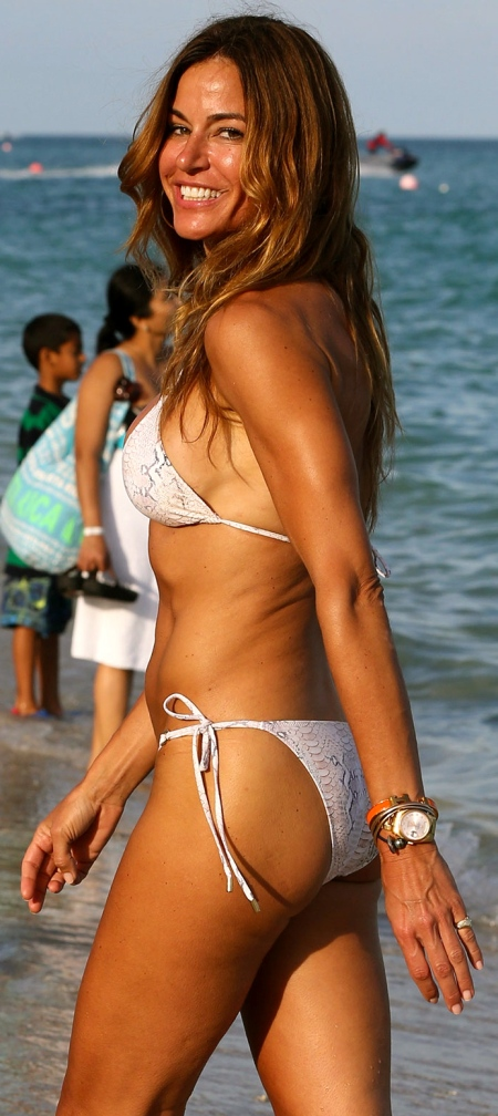 KELLY BENSIMON in a Snakeskin Print Bikini at a Beach in Miami