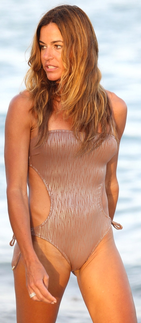 KELLY BENSIMON in Swimsuit at a Beach in Miami