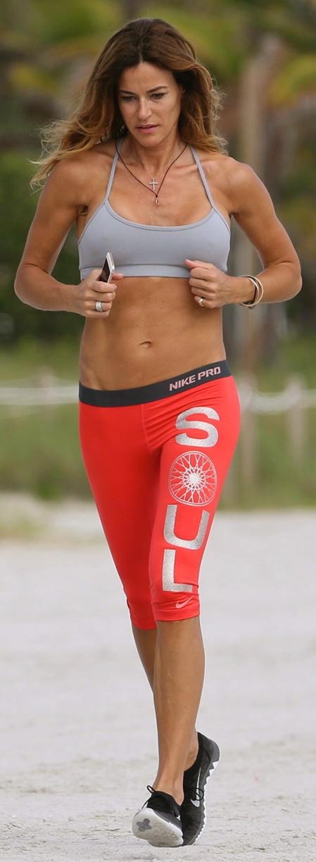 KELLY BENSIMON Jogging on the Beach in Miami