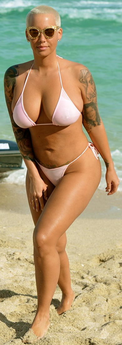 January 19, 2015: ***EXCLUSIVE*** Amber Rose wears a pink thong bikini on the beach and goes for a ride on a jet ski in Miami. Mandatory Credit: INFphoto.com Ref: infusmi-11/13