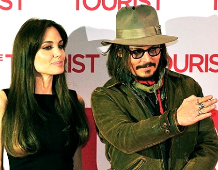 (From L) US actress Angelina Jolie and US actor Johnny Depp pose for photographers during a photo-call for the movie The Tourist, by German director Florian Henckel von Donnersmarck, in Berlin December 14, 2010. The movie will have its European premiere December 14, 2010. AFP PHOTO / JOHN MACDOUGALL (Photo credit should read JOHN MACDOUGALL/AFP/Getty Images)